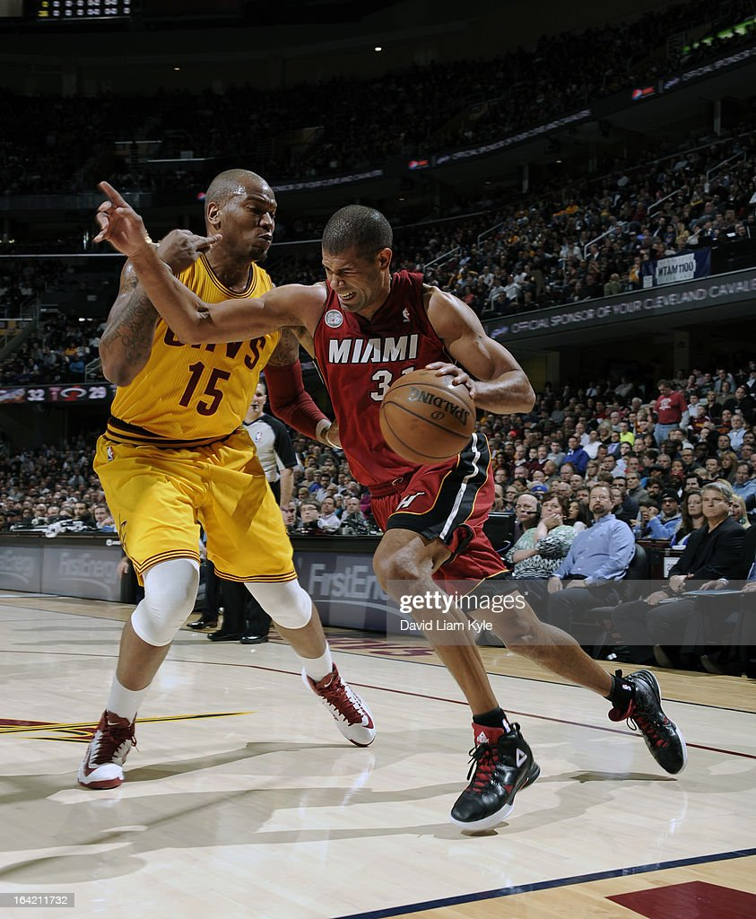 Shane Battier #31 of the Miami Heat drives to the hoop against Marreese Speights #15 of the Cleveland Cavaliers at The Quicken Loans Arena on March 20, 2013 in Cleveland, Ohio.