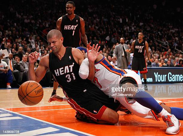 Shane Battier of the Miami Heat fights for control of a loose ball in the third quarter against Carmelo Anthony of the New York Knicks in Game Three...
