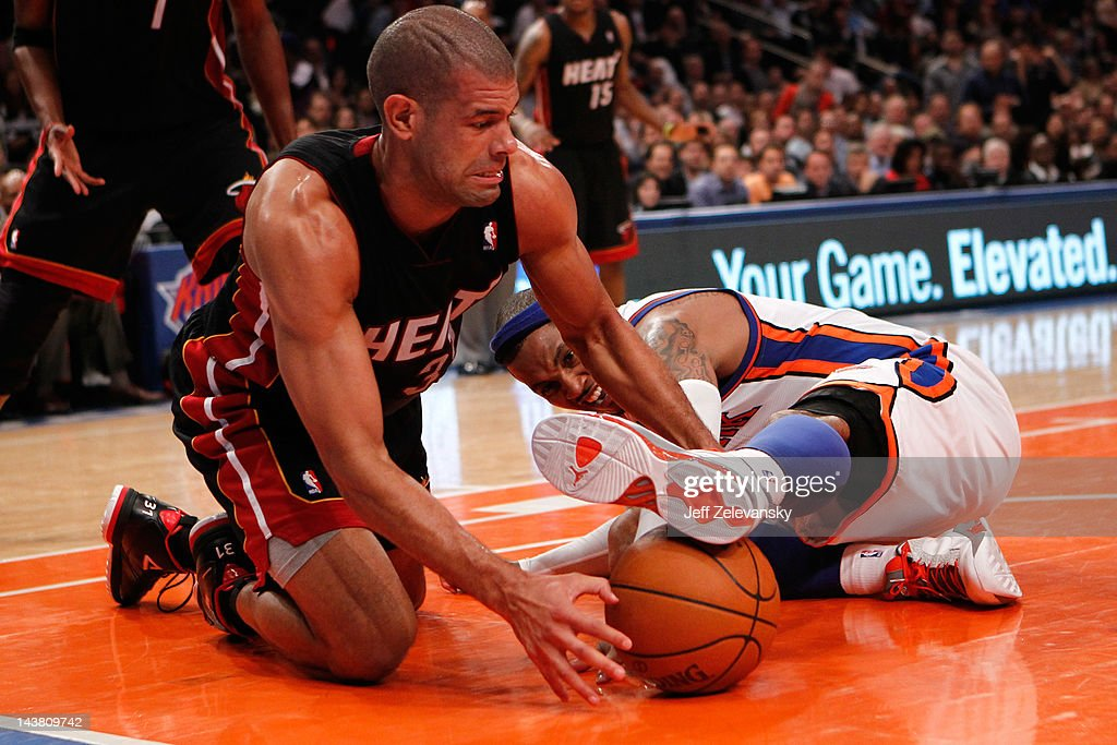 <a gi-track='captionPersonalityLinkClicked' href=/galleries/search?phrase=Shane+Battier&family=editorial&specificpeople=201814 ng-click='$event.stopPropagation()'>Shane Battier</a> #31 of the Miami Heat fights for control of a loose ball in the third quarter against <a gi-track='captionPersonalityLinkClicked' href=/galleries/search?phrase=Carmelo+Anthony&family=editorial&specificpeople=201494 ng-click='$event.stopPropagation()'>Carmelo Anthony</a> #7 of the New York Knicks in Game Three of the Eastern Conference Quarterfinals in the 2012 NBA Playoffs on May 3, 2012 at Madison Square Garden in New York City.