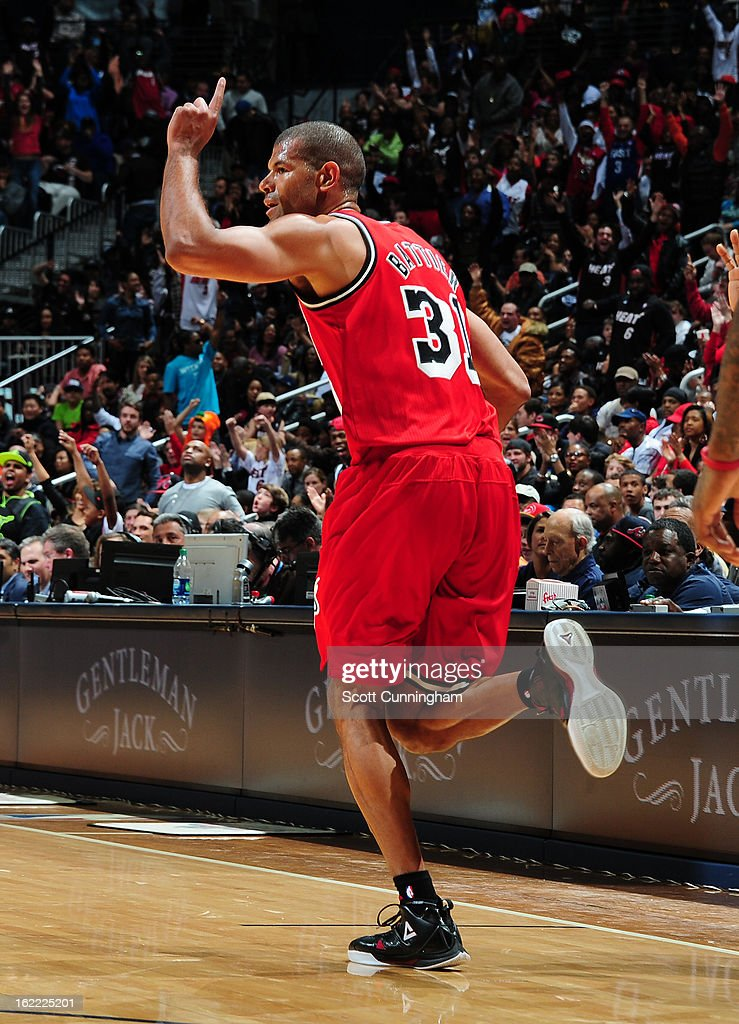 Shane Battier #31 of the Miami Heat holds his hand up in the air after hitting a shot against the Atlanta Hawks on February 20, 2013 at Philips Arena in Atlanta, Georgia.