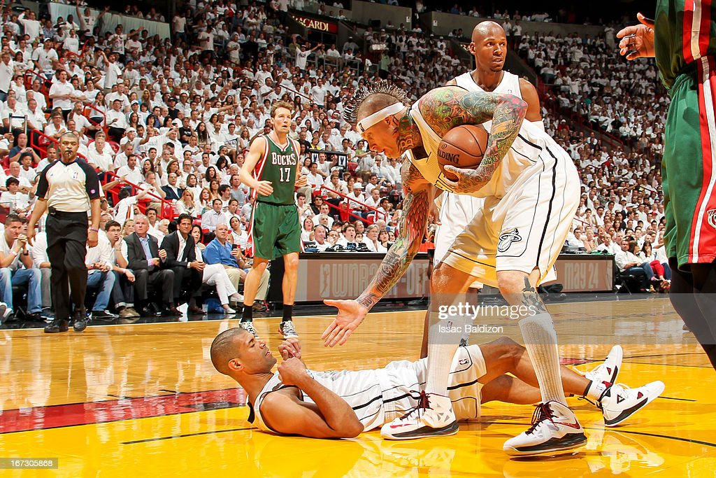 Shane Battier #31 of the Miami Heat is helped up by teammate Chris Andersen #11 while playing against the Milwaukee Bucks in Game Two of the Eastern Conference Quarterfinals during the 2013 NBA Playoffs on April 23, 2013 at American Airlines Arena in Miami, Florida.