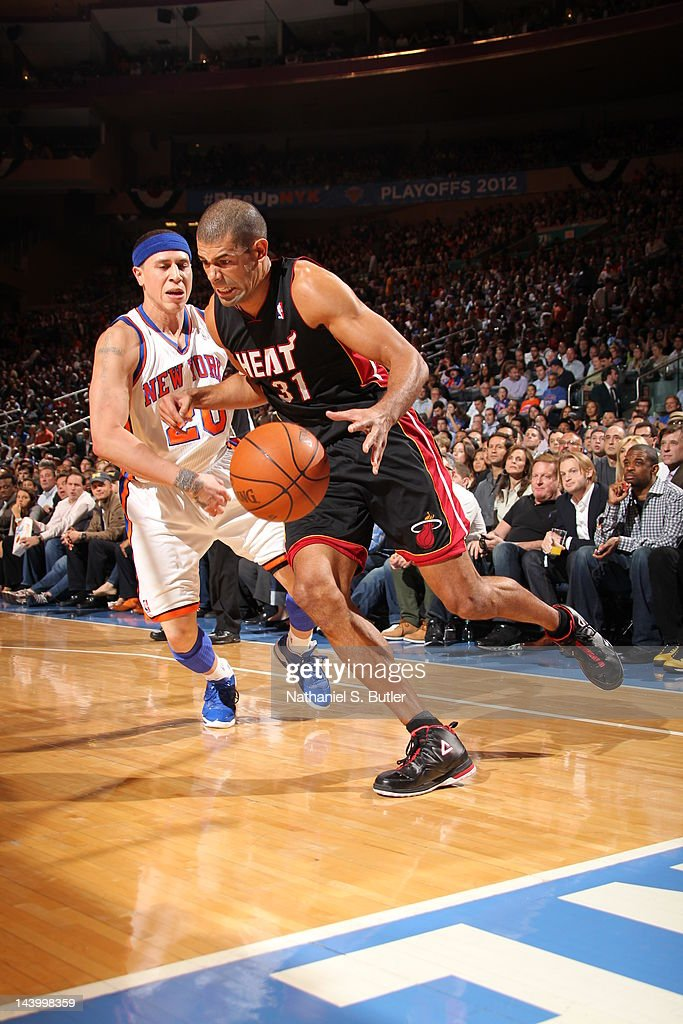 Shane Battier #31 of the Miami Heat moves the ball against Mike Bibby #20 of the New York Knicks in Game Four of the Eastern Conference Quarterfinals during the 2012 NBA Playoffs on May 6, 2012 at Madison Square Garden in New York City.