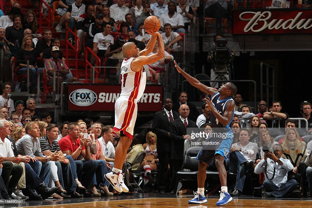 Shane Battier #31 of the Miami Heat shoots against Darren Collison #4 of the Dallas Mavericks on January 2, 2013 at American Airlines Arena in Miami, Florida.