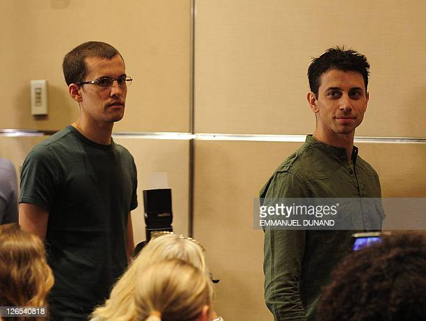 Shane Bauer and Josh Fattal two US hikers held by Iran for more than two years on spying charges arrive at a press conference after arriving back in...