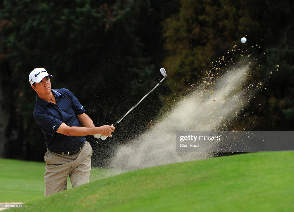 Shane Bertsch hits from a bunker on the third hole during the third round of the Colombia Championship at Country Club de Bogota on March 2, 2013 in Bogota, Colombia.