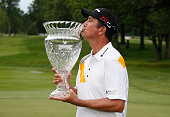 Shane Bertsch kisses the winners trophy after winning the Webcom Tour RustOleum Championship at the Lakewood Country Club on June 14 2015 in Westlake...