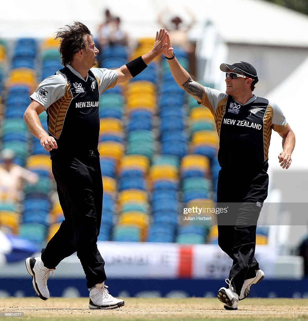 Shane Bond and Brendon McCullum of New Zealand celebrate the dismissal of Mohammad Hafeez during The ICC World Twenty20 Super Eight match between New...