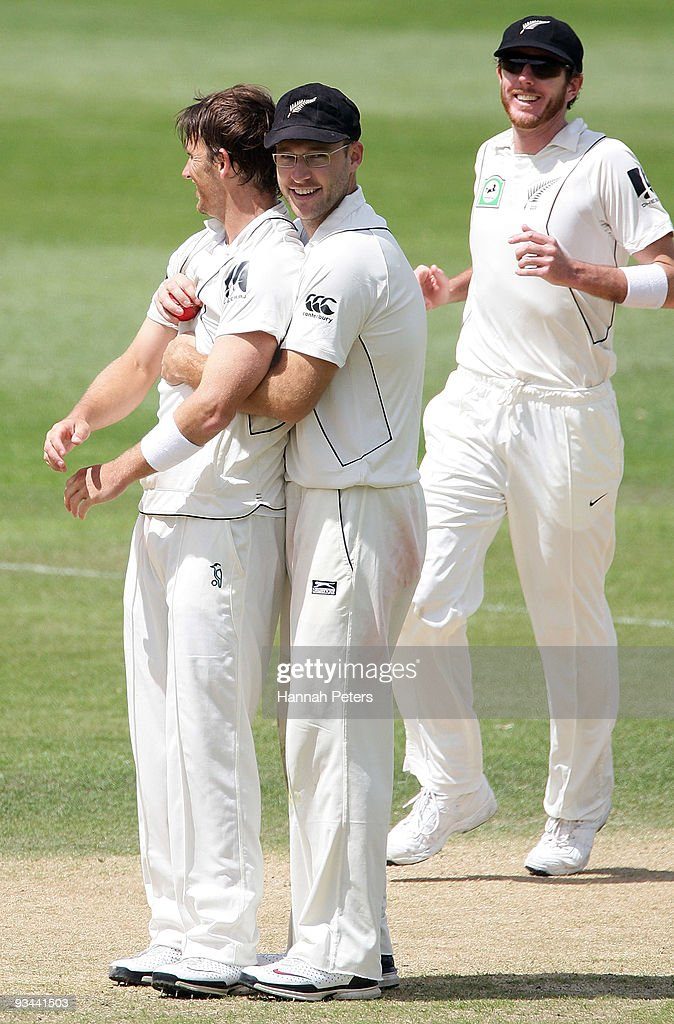 Shane Bond is congratulated by Daniel Vettori after taking a five wicket haul during day four of the First Test match between New Zealand and...
