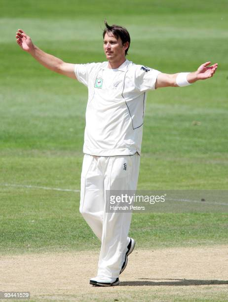 Shane Bond of New Zealand celebrates taking a five wicket haul during day four of the First Test match between New Zealand and Pakistan at University...