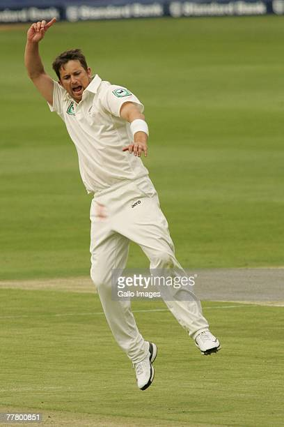 Shane Bond of New Zealand celebrates taking the wicket of Andre Nel of South Africa during day one of the first test match between South Africa and...