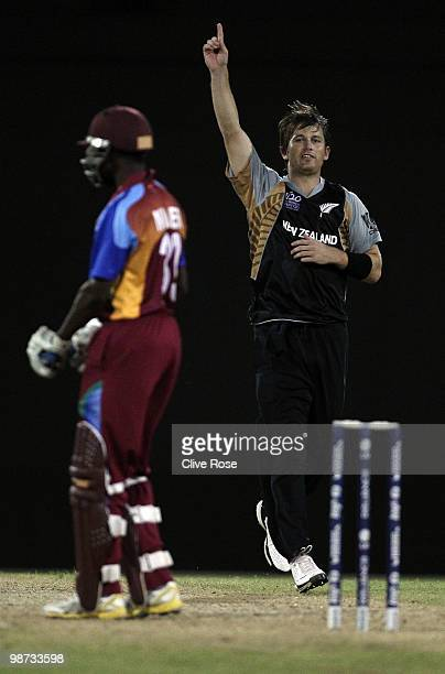 Shane Bond of New Zealand celebrates the wicket of Nikita Miller of West Indies during the ICC T20 World Cup warm up match between West Indies and...