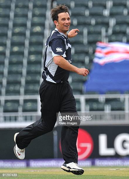 Shane Bond of New Zealand celebrates the wicket of Owais Shah of England for 3 runs during the ICC Champions Trophy match between England and New...