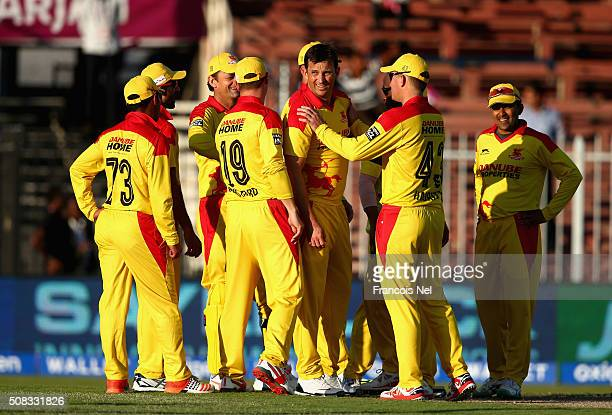 Shane Bond of Sagittarius Strikers celebrate the wicket of Michael Lumb of Libra Legends during the Oxigen Masters Champions League match between...