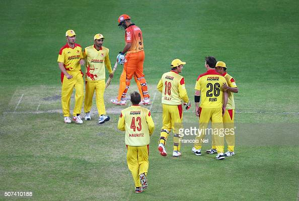Shane Bond of Sagittarius Strikers is congratulated by team mates after taking the wicket of Neil McKenzie of Virgo Super Kings during the Oxigen...