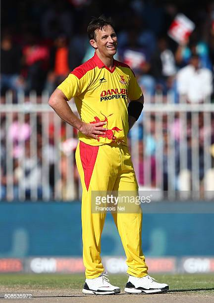 Shane Bond of Sagittarius Strikers reacts after being hit for six by Virender Sehwag of Gemini Arabians during the Oxigen Masters Champions League...