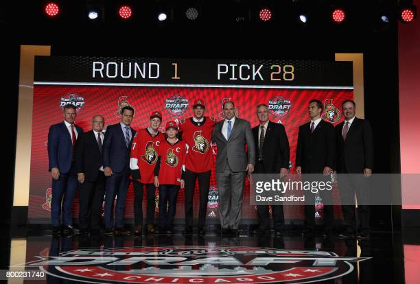 Shane Bowers poses onstage after being selected 28th overall by the Ottawa Senators during Round One of the 2017 NHL Draft at United Center on June...