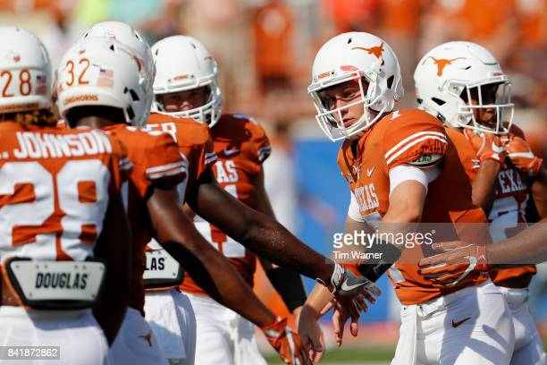 Shane Buechele of the Texas Longhorns greets teammates before the game against the Maryland Terrapins at Darrell K RoyalTexas Memorial Stadium on...