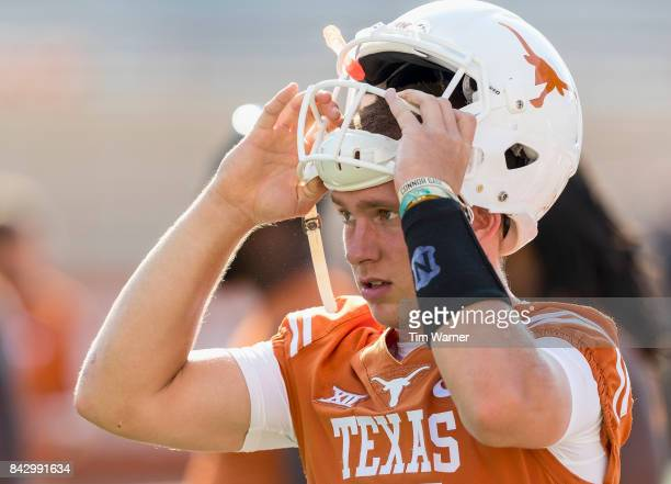 Shane Buechele of the Texas Longhorns prepares to warm up before the game against the Maryland Terrapins at Darrell K RoyalTexas Memorial Stadium on...