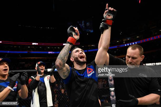 Shane Burgos celebrates his technical knockout victory over Charles Rosa in their featherweight bout during the UFC 210 event at KeyBank Center on...