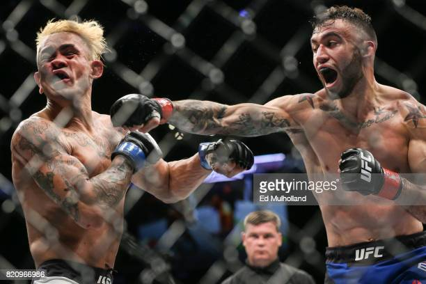 Shane Burgos lands a right hand on Godofredo Pepey during their UFC Fight Night featherweight bout at the Nassau Veterans Memorial Coliseum on July...