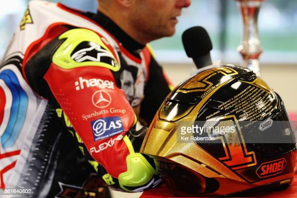 Shane Byrne of Be Wiser Ducati Racing Team is interviewed while displaying a special riders helmet after winning the British Superbike Championship...