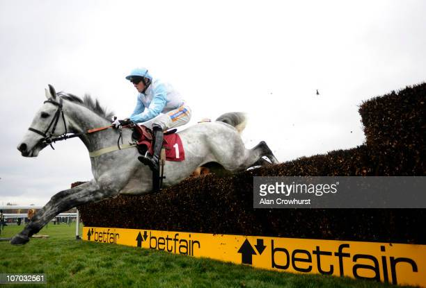 Shane Byrne riding Stagecoach Pearl on their way to winning The Follow Paul Nicholls On Facebook And Twitter Handicap Steeple Chase at Haydock Park...