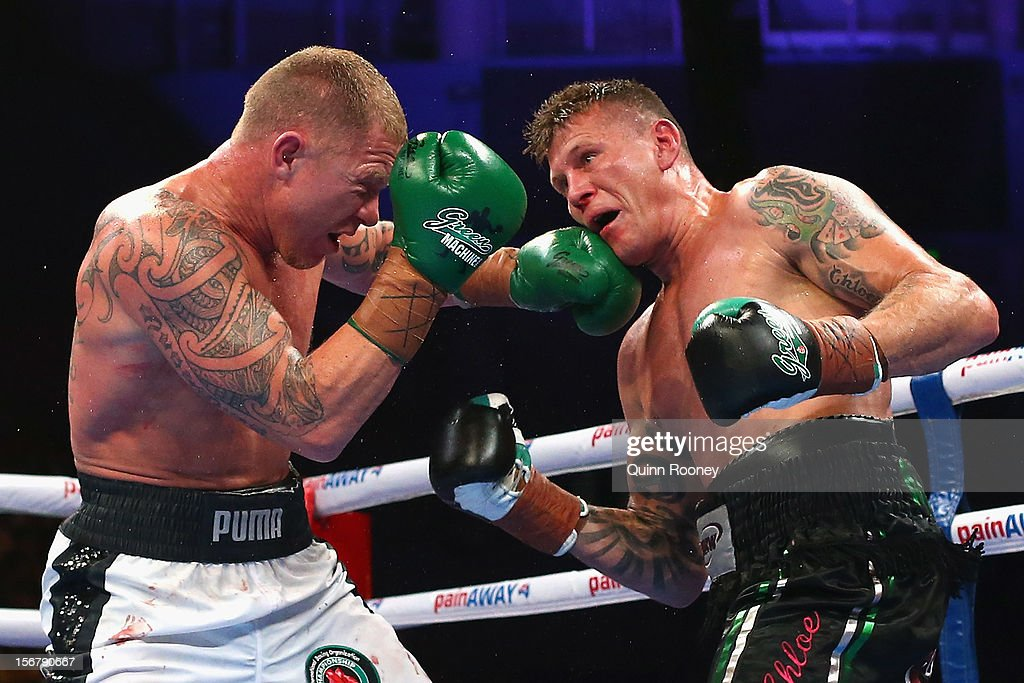 Shane Cameron of New Zealand and Danny Green of Australia exchange blows during their world title bout at Hisense Arena on November 21, 2012 in Melbourne, Australia.