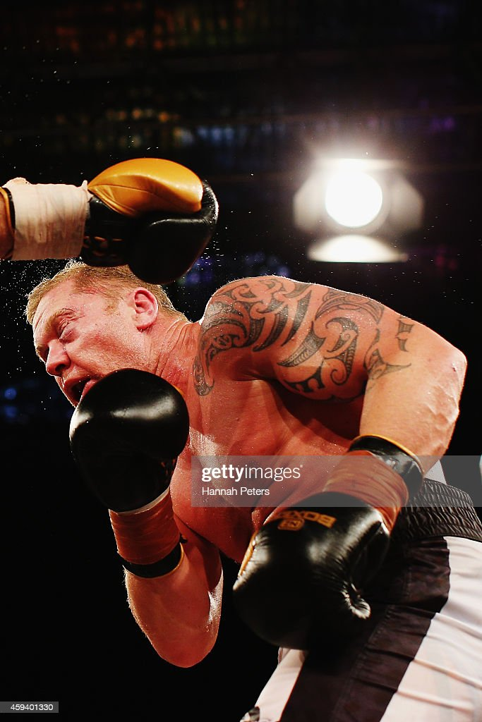 Shane Cameron of New Zealand is punched by Kali Meehan of New Zealand during the Heavyweight Title bout between Shane Cameron and Kali Meehan at...