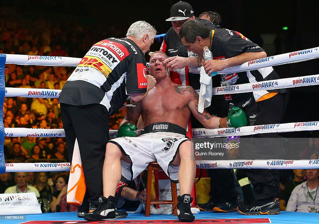 Shane Cameron of New Zealand is seen to by his trainers during his world title bout against Danny Green of Australia at Hisense Arena on November 21, 2012 in Melbourne, Australia.