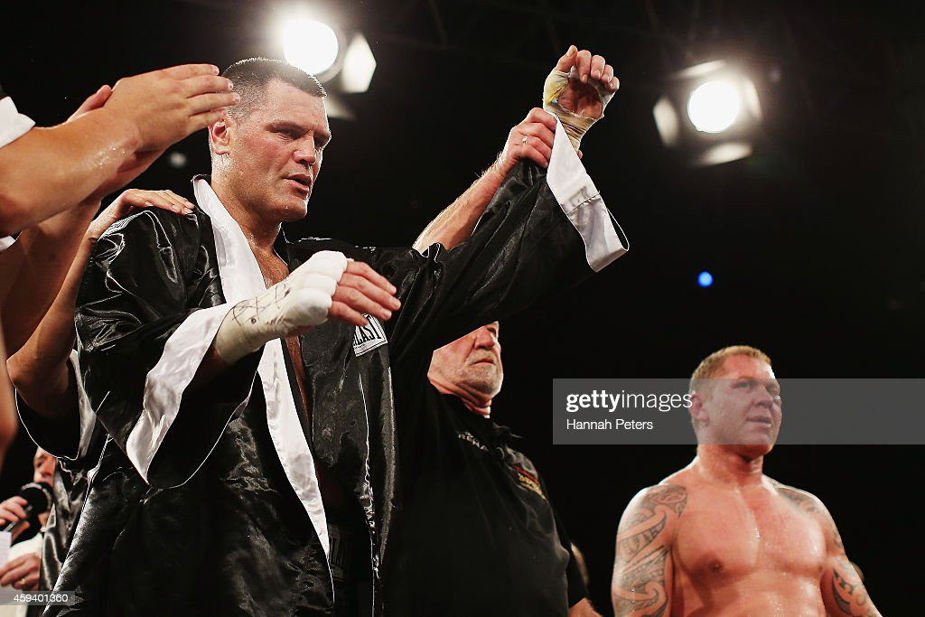 Shane Cameron of New Zealand looks on as Kali Meehan of New Zealand celebrates winning the Heavyweight Title bout between Shane Cameron and Kali...