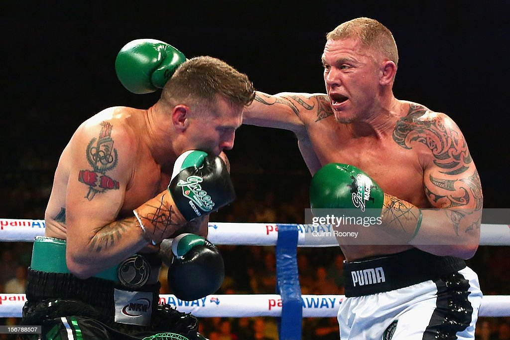 Shane Cameron of New Zealand punches Danny Green of Australia during their world title bout at Hisense Arena on November 21 2012 in Melbourne...