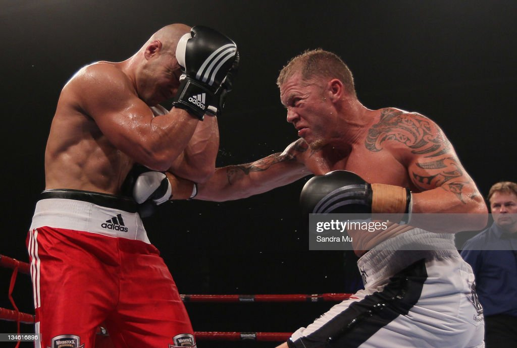 Shane Cameron punches Monty Betham during the Fight For Life League vs Union Night at The Trusts Stadium on December 3 2011 in Auckland New Zealand