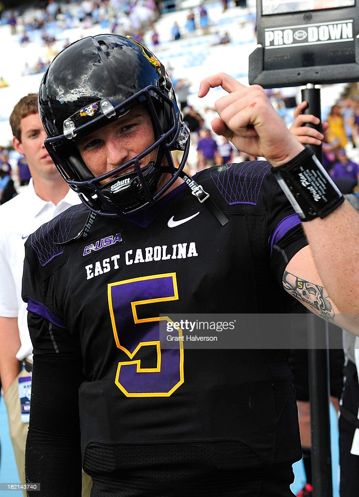 Shane Carden #5 of the East Carolina Pirates celebrates after a win over the North Carolina Tar Heels at Kenan Stadium on September 28, 2013 in Chapel Hill, North Carolina. East Carolina won 55-31.
