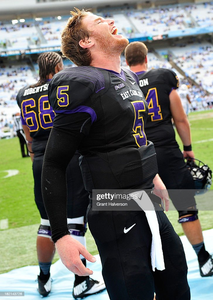 Shane Carden #5 of the East Carolina Pirates celebrates during the final seconds of a win over the North Carolina Tar Heels at Kenan Stadium on September 28, 2013 in Chapel Hill, North Carolina. East Carolina won 55-31.