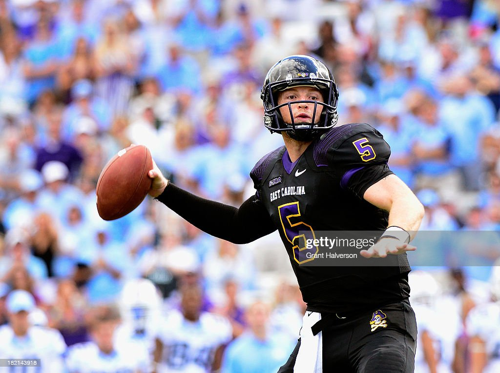 Shane Carden #5 of the East Carolina Pirates drops back to pass against the North Carolina Tar Heels during play at Kenan Stadium on September 28, 2013 in Chapel Hill, North Carolina. East Carolina won 55-31.