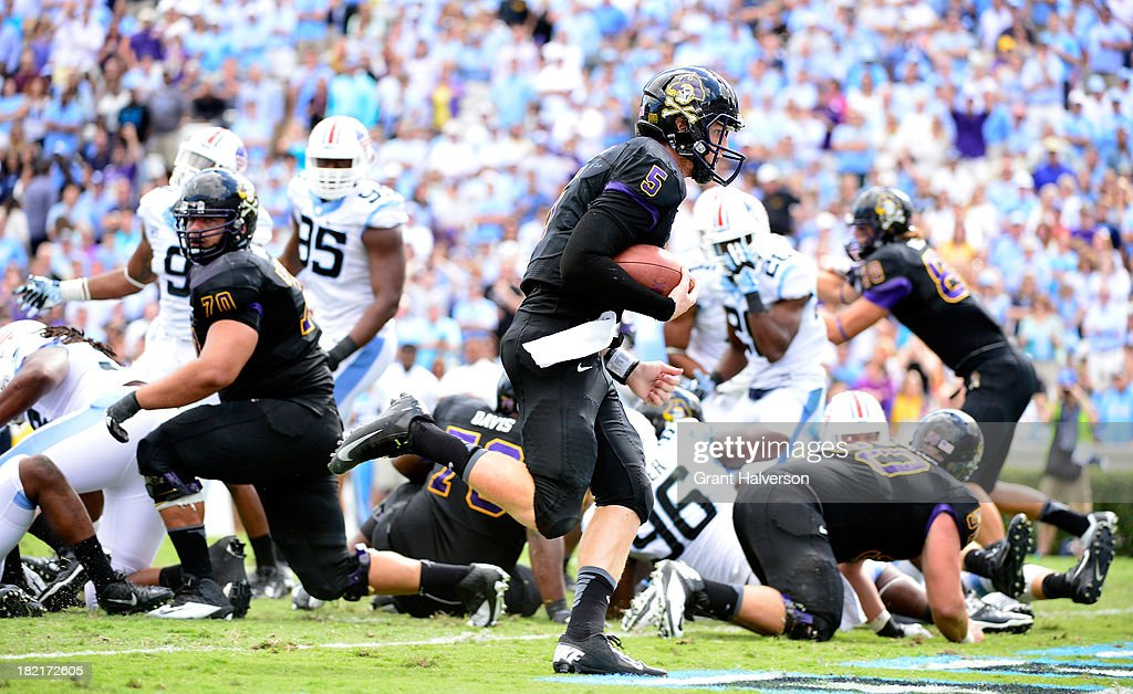 Shane Carden #5 of the East Carolina Pirates runs untouched into the end zone for a touchdown against the North Carolina Tar Heels during play at Kenan Stadium on September 28, 2013 in Chapel Hill, North Carolina. East Carolina won 55-31.
