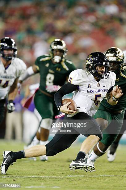 Shane Carden of the East Carolina Pirates runs with the ball in the fourth quarter of the game against the South Florida Bulls at Raymond James...