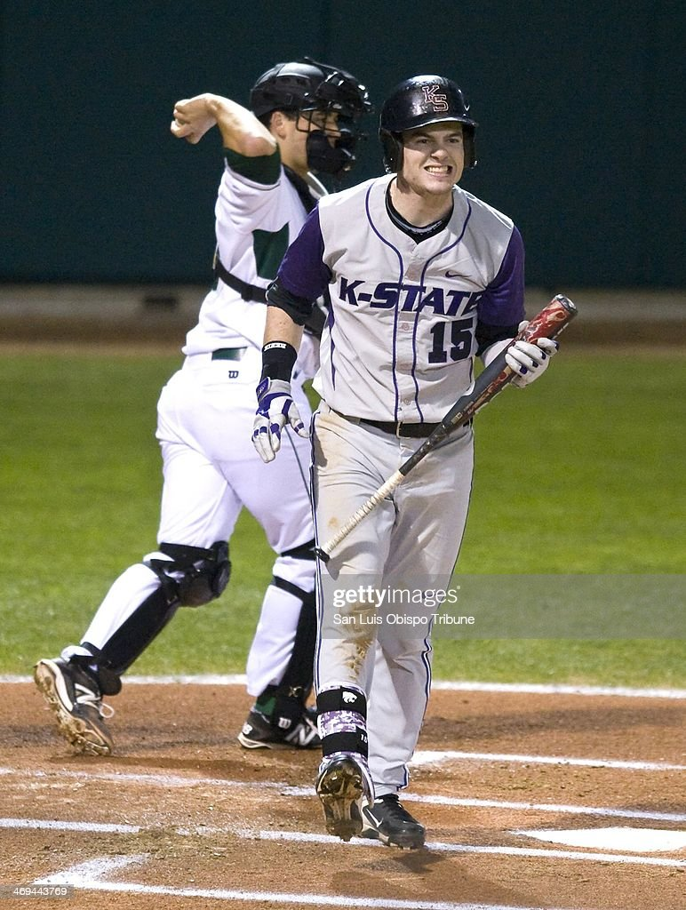 Shane Conlon of Kansas State grimaces after striking out as Cal Poly catcher Chris Hoo throws the ball back to pitcher Matt Imhof in San Luis Obispo...