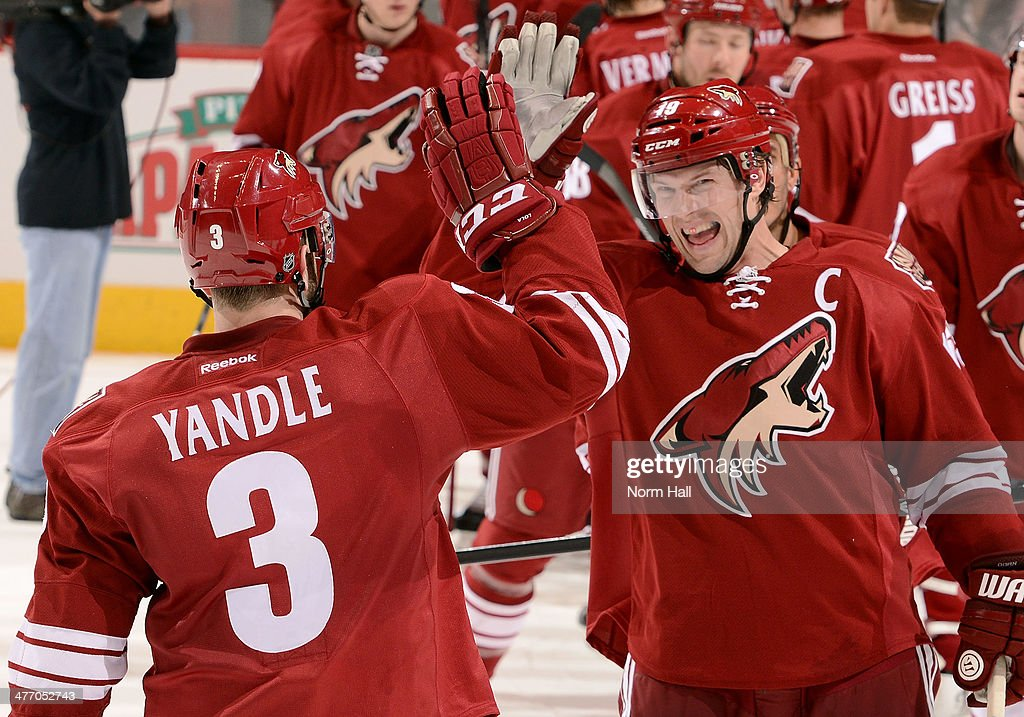 <a gi-track='captionPersonalityLinkClicked' href=/galleries/search?phrase=Shane+Doan&family=editorial&specificpeople=201614 ng-click='$event.stopPropagation()'>Shane Doan</a> #19 and <a gi-track='captionPersonalityLinkClicked' href=/galleries/search?phrase=Keith+Yandle&family=editorial&specificpeople=606912 ng-click='$event.stopPropagation()'>Keith Yandle</a> #3 of the Phoenix Coyotes celebrate their 5-2 victory against the Montreal Canadiens at Jobing.com Arena on March 6, 2014 in Glendale, Arizona.