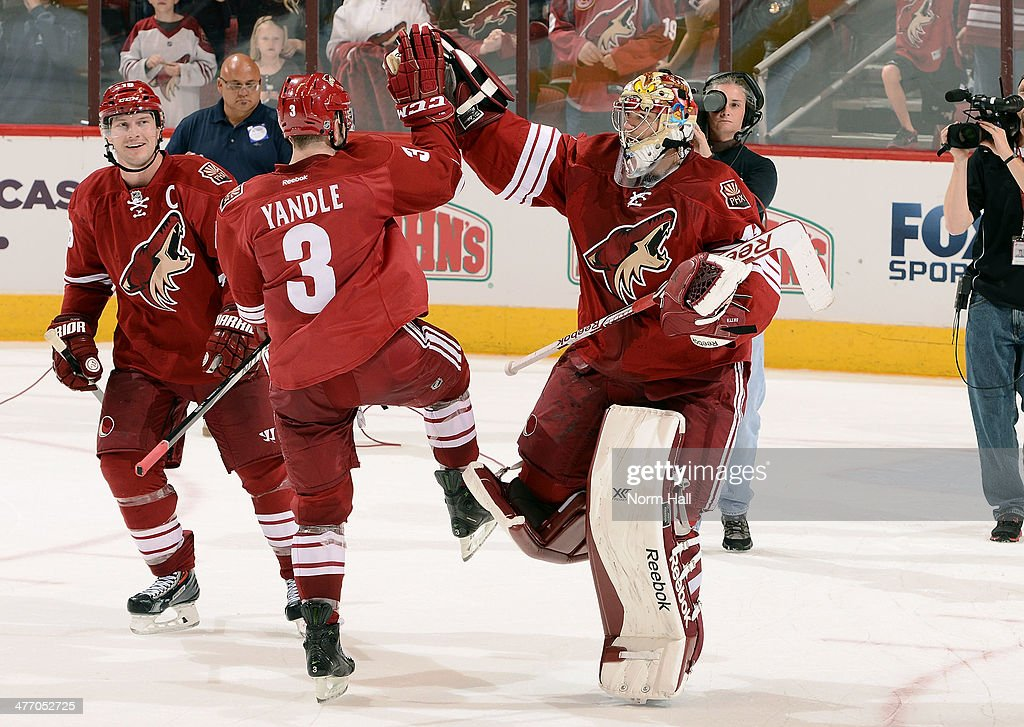 <a gi-track='captionPersonalityLinkClicked' href=/galleries/search?phrase=Shane+Doan&family=editorial&specificpeople=201614 ng-click='$event.stopPropagation()'>Shane Doan</a> #19 and <a gi-track='captionPersonalityLinkClicked' href=/galleries/search?phrase=Keith+Yandle&family=editorial&specificpeople=606912 ng-click='$event.stopPropagation()'>Keith Yandle</a> #3 of the Phoenix Coyotes congratulate goaltender Mike Smith #41 following their 5-2 victory against the Montreal Canadiens at Jobing.com Arena on March 6, 2014 in Glendale, Arizona.