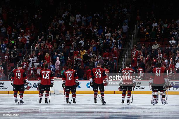 Shane Doan Jordan Martinook Brad Richardson Michael Stone Oliver EkmanLarsson and goaltender Mike Smith of the Arizona Coyotes stand attended for the...