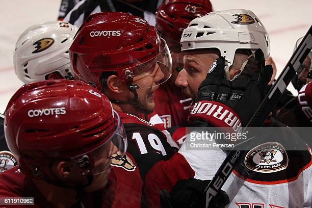 Shane Doan of the Arizona Coyotes and Nick Tarnasky of the Anaheim Ducks come together in a scrum during the second period of the preseason NHL game...