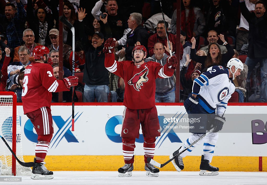 Shane Doan of the Arizona Coyotes celebrates alongside Keith Yandle after Doan scored a second period power play goal against Adam Pardy and the...