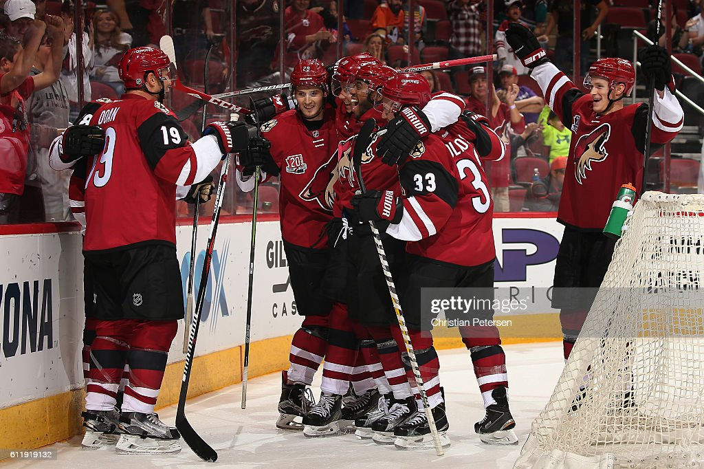 Shane Doan #19 (L) of the Arizona Coyotes celebrates with teammates Brendan Perlini #29, Dylan Strome #20, Anthony Duclair #10, Alex Goligoski #33 and Jakob Chychrun #6 after Doan scored the game winning goal against Anaheim Ducks in overtime of the preseason NHL game at Gila River Arena on October 1, 2016 in Glendale, Arizona. The Coyotes defeated the Ducks 3-2 in overtime.