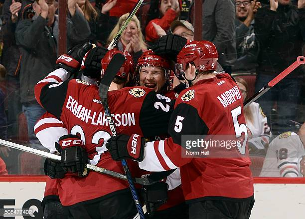 Shane Doan of the Arizona Coyotes celebrates with teammates Oliver EkmanLarsson and Connor Murphy after his third period goal against the Chicago...