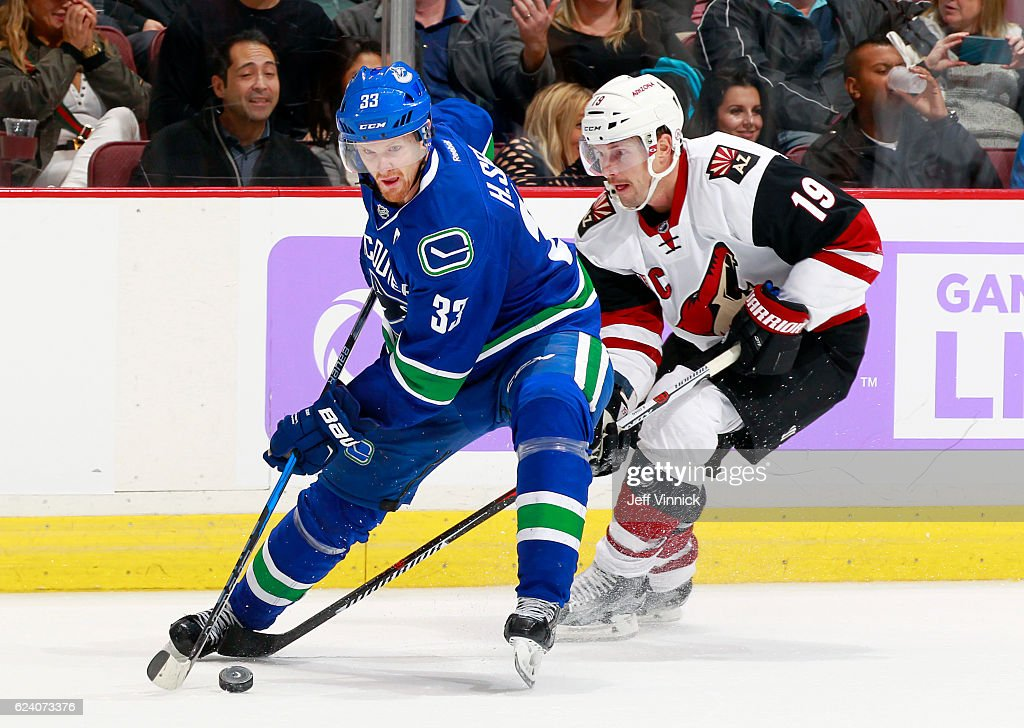 Shane Doan #19 of the Arizona Coyotes checks Henrik Sedin #33 of the Vancouver Canucks during their NHL game at Rogers Arena November 17, 2016 in Vancouver, British Columbia, Canada. Vancouver won 3-2 in overtime. Hutton was a warded a penalty shot on the play.