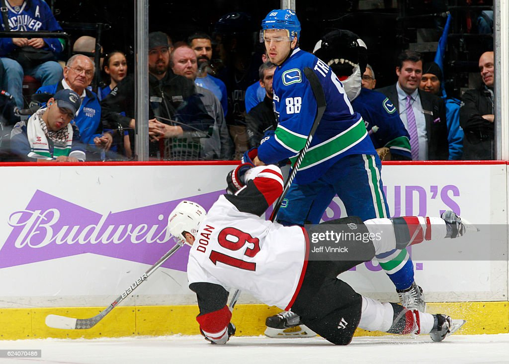 Shane Doan #19 of the Arizona Coyotes collides with Nikita Tryamkin #88 of the Vancouver Canucks during their NHL game at Rogers Arena November 17, 2016 in Vancouver, British Columbia, Canada. Vancouver won 3-2 in overtime.