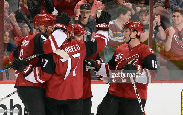 Shane Doan of the Arizona Coyotes skates in to join the celebration with teammates Jakob Chychrun Anthony DeAngelo and Tobias Rieder after a second...