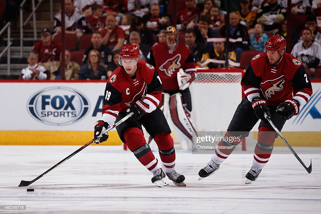 Shane Doan of the Arizona Coyotes skates with the puck during the NHL game against the Pittsburgh Penguins at Gila River Arena on October 10 2015 in...