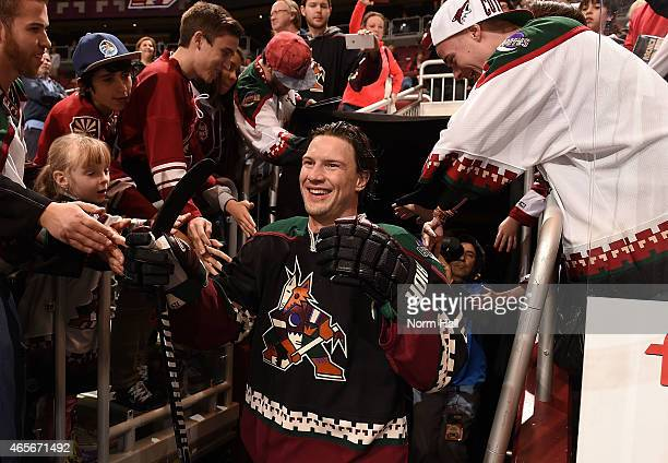 Shane Doan of the Arizona Coyotes takes the ice wearing a throwback uniform during pregame against the Vancouver Canucks at Gila River Arena on March...